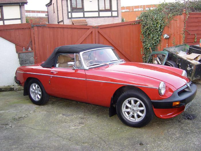 "These are a few  pictures of my 1975 Tartan Red, fully restored MGB.  As you can see it has a cockpit and body to die for. Recently I was driving through a town centre behind an open top Audi TT. when a group of teenagers shouted ""Lovely car mate"". The TT owner turned around to thank them to find that they were taking to me not him! Long may it last!"