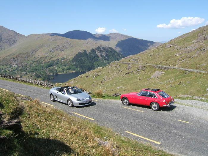 Jack Burkitt's 1967 MGBGT ascends the Healy pass near Killarney as Peter and Mary Davey descend in their MGF