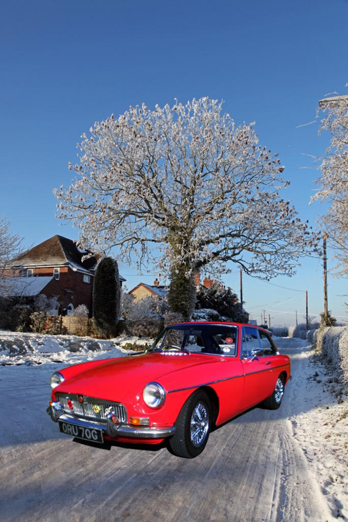 My pride and joy on a snowy lane in my Village(Photoshopped Image)Not too long after its return from the 50MGB Celebrations at Blenheim Palace